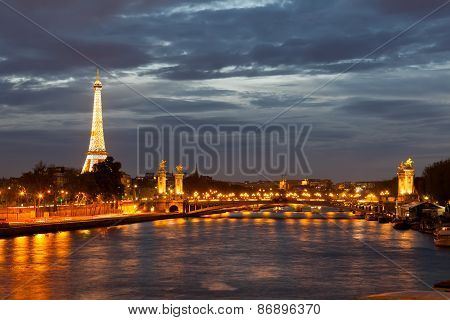 view From The Embankment On The River Seine And The Eiffel Tower In Night