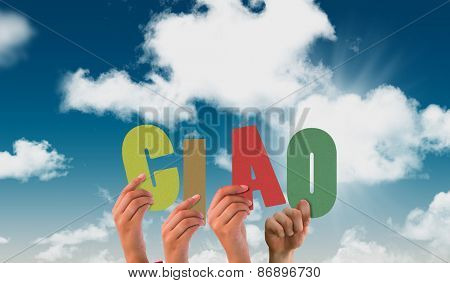 Hands holding up ciao against blue sky