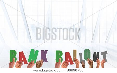 Hands holding up bank bailout against white room with large window