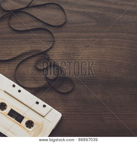retro audio cassette over wooden background