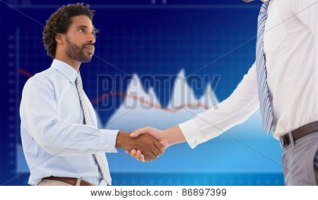 Young businessmen shaking hands in office against business interface with graphs and data