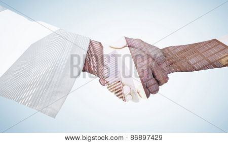 Extreme closeup of a doctor and patient shaking hands against skyscraper