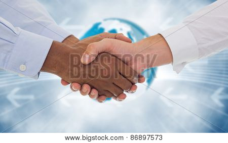 Close-up shot of a handshake in office against global business graphic in blue