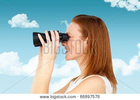 Charismatic businesswoman predicting future success against blue sky