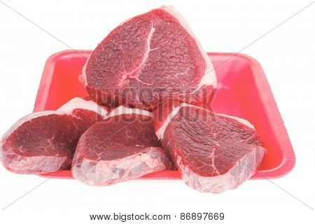 uncooked meat : raw fresh beef pork tenderloin strip ready to cooking on red tray isolated over white background