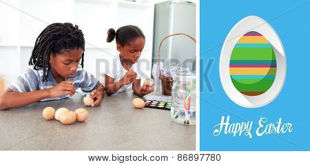 happy easter against concentrated siblings painting eggs