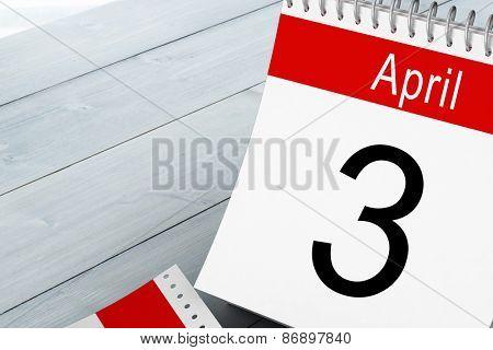 April calendar against bleached wooden planks background
