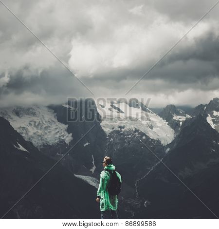 male traveller and summer mountain stormy landscape