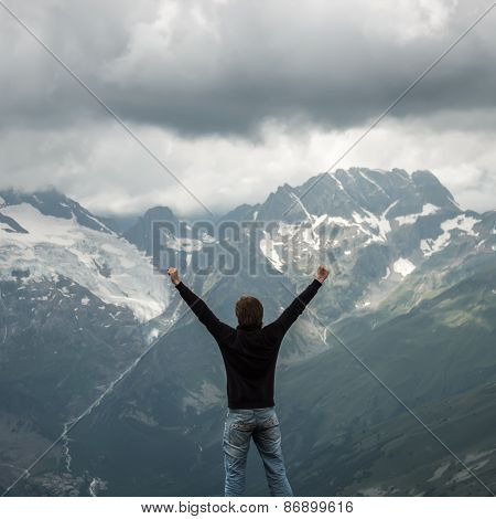 traveller and summer mountain stormy landscape