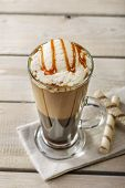 foto of frappe  - cold coffee with ice cream and caramel in a glass - JPG