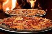 picture of hot fresh pizza  - italian original fresh pizza restaurant on wooden fire - JPG