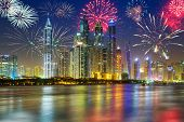 stock photo of firework display  - Fireworks display on the sky in Dubai city - JPG