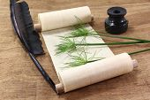 stock photo of inkwells  - Papyrus scroll with plant quill and inkwell - JPG