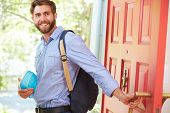 pic of leaving  - Young Man Leaving Home For Work With Packed Lunch - JPG