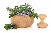 stock photo of purple sage  - Herb leaf selection of golden thyme oregano purple sage mint and rosemary in flower in a beech wood mortar with pestle isolated over white background - JPG