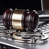 image of handcuff  - handcuffs and judge gavel on computer cyber crime concept - JPG