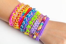 picture of rubber band  - Colorful rubber rainbow loom band bracelets on hand trendy kids fashion accessories - JPG