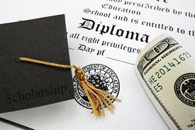 stock photo of tassels  - graduation cap with Scholarship text and money on a high school diploma - JPG