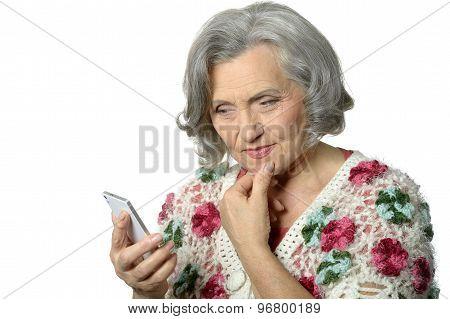 Portrait of elderly lady holding mobile phone