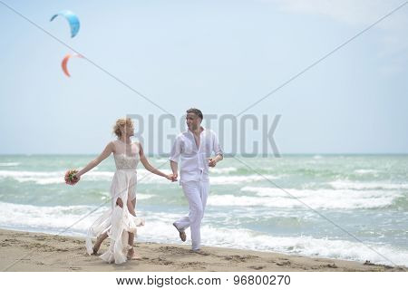 Tender Wedding Couple On Beach