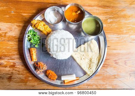 Delicious Nepali Thali meal set with chicken curry