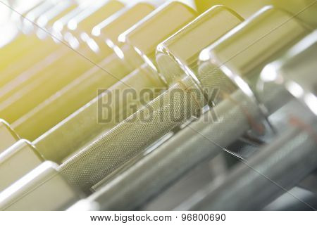 Metal Rustic Dumbbells  Closeup With Yellow Gradient Soft Light.