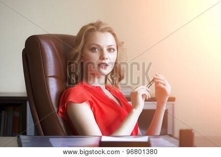 Elegant Business Woman In Chair