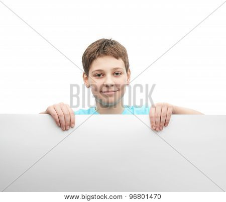 Happy young boy with a sheet of paper