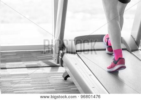 Unknown Woman  In Pink Shoes Running On Treadmill Split Pink Tone