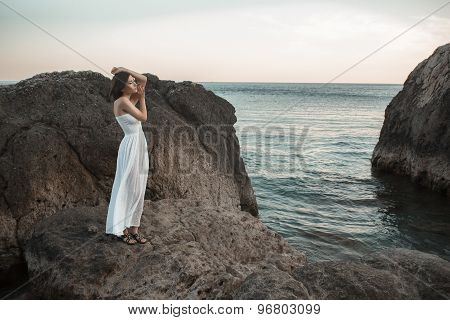 Woman relaxing at the beach with arms open
