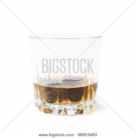 Glass tumbler filled with whiskey