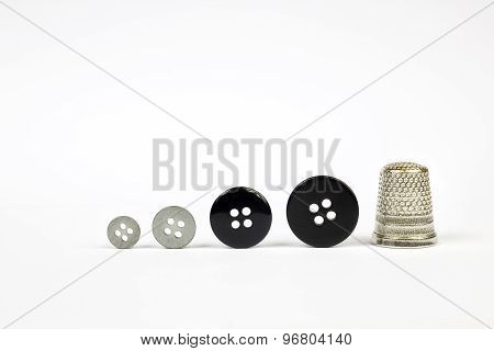 Buttons and thimble
