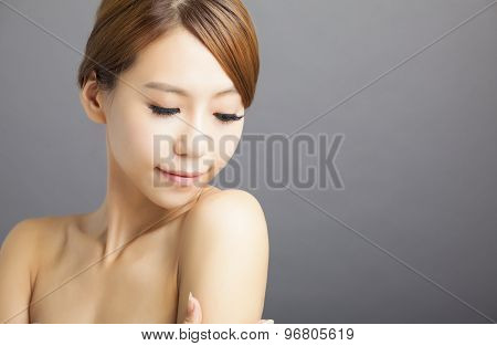 closeup young woman face on gray background