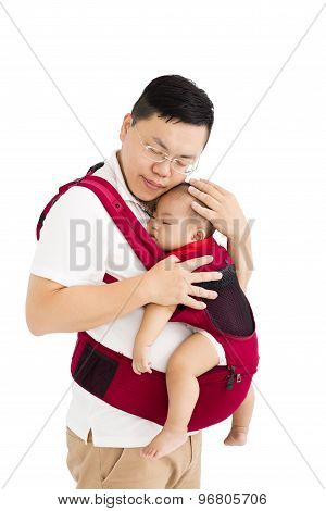 Father  Holding A Baby In A Baby Carrier