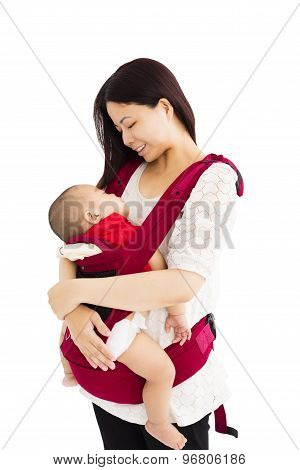Mother Holding A Baby In A Baby Carrier