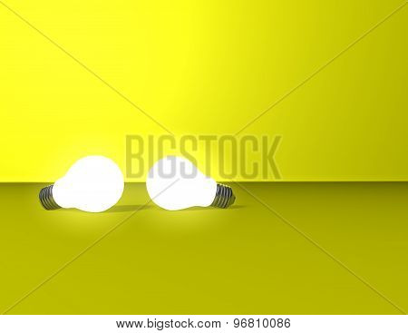 Two Light Bulbs On Yellow Background