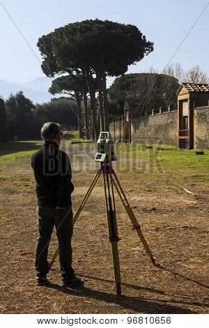Surveyor At Pompeii Ruins In Italy