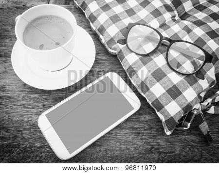 Mobile Phone And Coffee On Wooden Floor