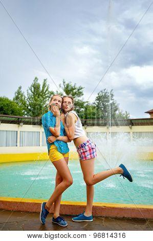 Best Girlfriends In Park Near The Fountain.