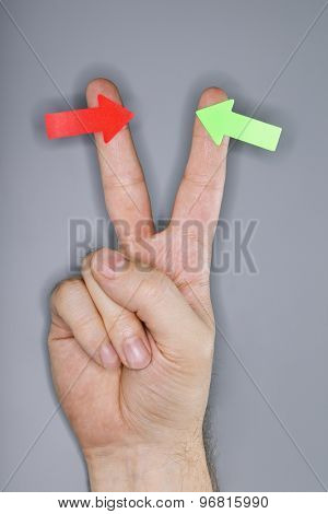 A hand with arrow stickers. Very short depth-of-field and ring flash lighting.