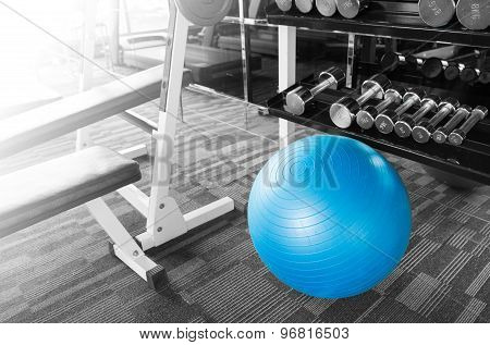 Fitness Gym With Ball, Dumbell And Other Equipment With Shining Light.