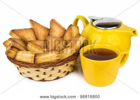 Sweet Puff Pastries In Wicker Basket, Teapot And Hot Tea