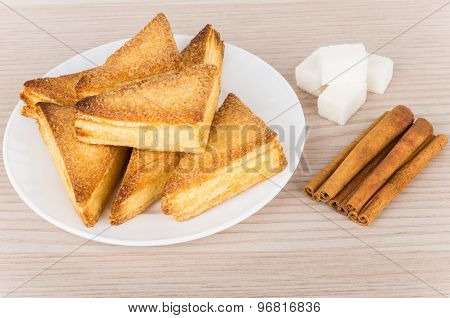 Puff Pastries In Plate, Pieces Of  Lumpy Sugar And Cinnamon