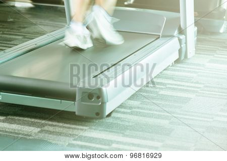 Woman Running With Treadmill With Motion Of Speed With Yellow Light