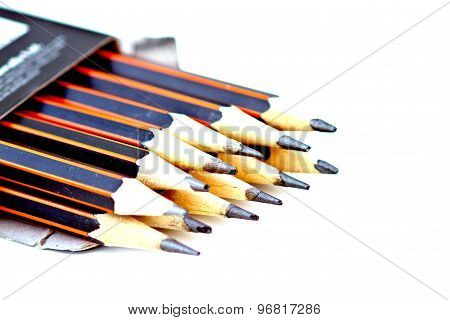 Pencils In A Box On A White Table.