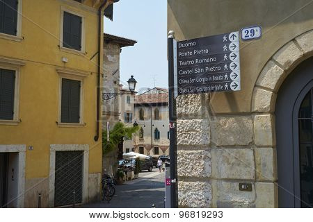 VERONA, ITALY - JULY 13: Direction signs near Ponte Pietra. July 13, 2015 in Verona.