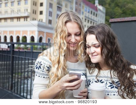 Two Happy Women Friends Sharing Social Media In A Smart Phone Outdoors In A City
