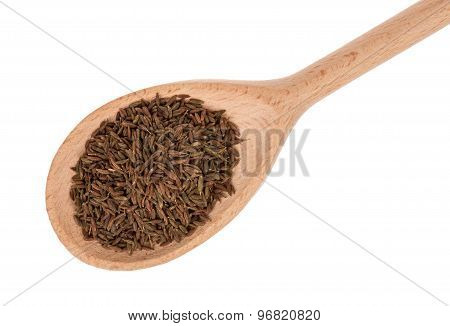 A wooden spoon with roman cumin.