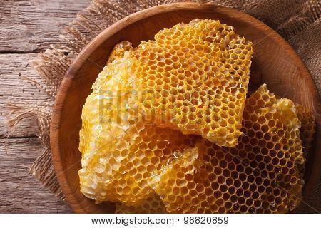 Golden Honeycombs On A Wooden Plate. Horizontal Top View Closeup