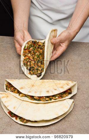 Chef making quesadillas.